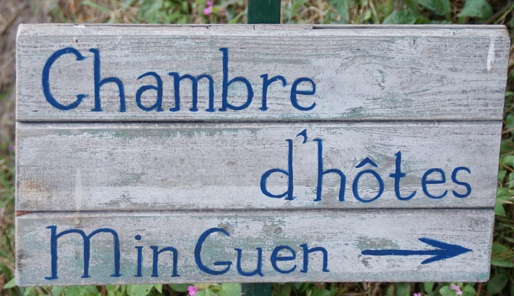 Min Guen sign
