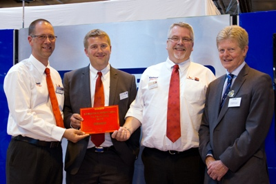 Genus ABS's Paul Nunn, Andy King and Dave Hodgson receive the award from RABDF president, Prof David Leaver