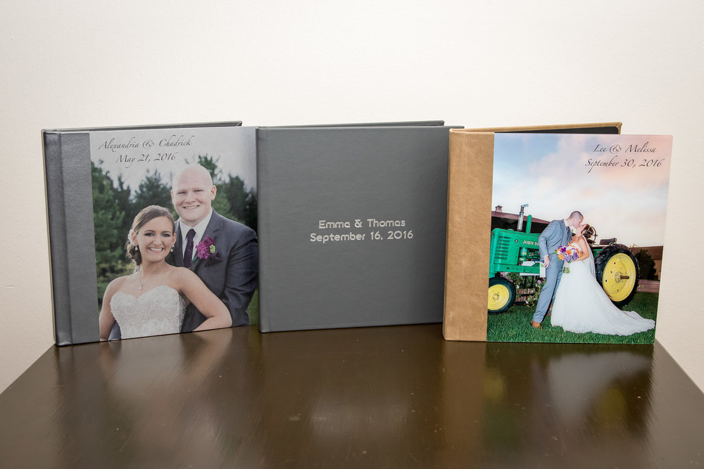 Our Wedding Album Line-up: (Left to Right) Metal Cover, Debossed Leather Cover, and Acrylic Cover.