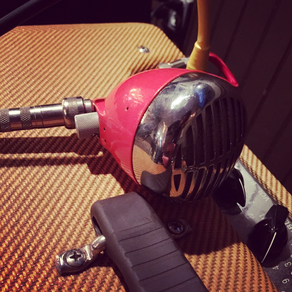 Icey's vintage 1958 Shure Bullet mic. Customized with an orange powder coat finish and chrome grill.