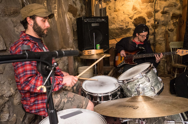 Stone walled basement serves the band well as practice space - Kevin Medeiros on drums, Lance Fullin on bass. —  Photo by Mark Lovewell
