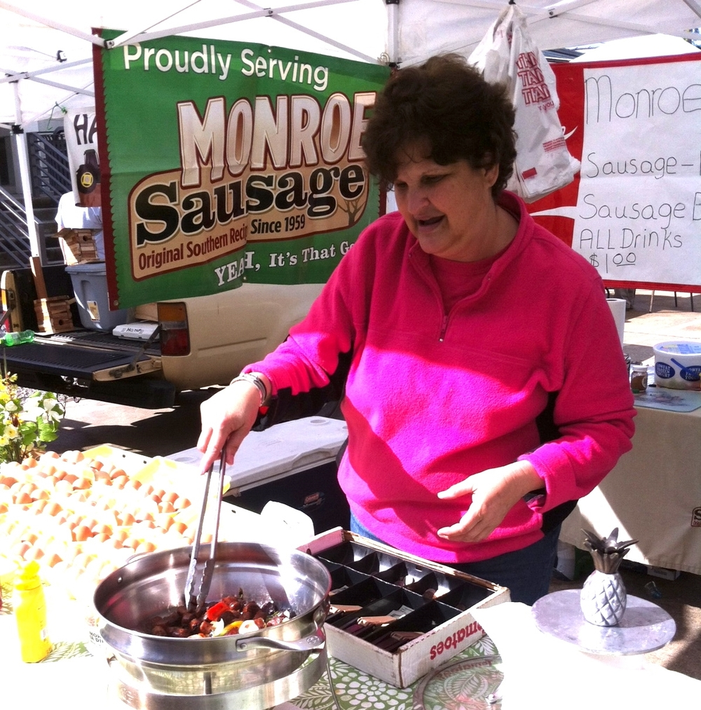 Debra Gardner of Monroe Sausage making Sausage Biscuits.jpg