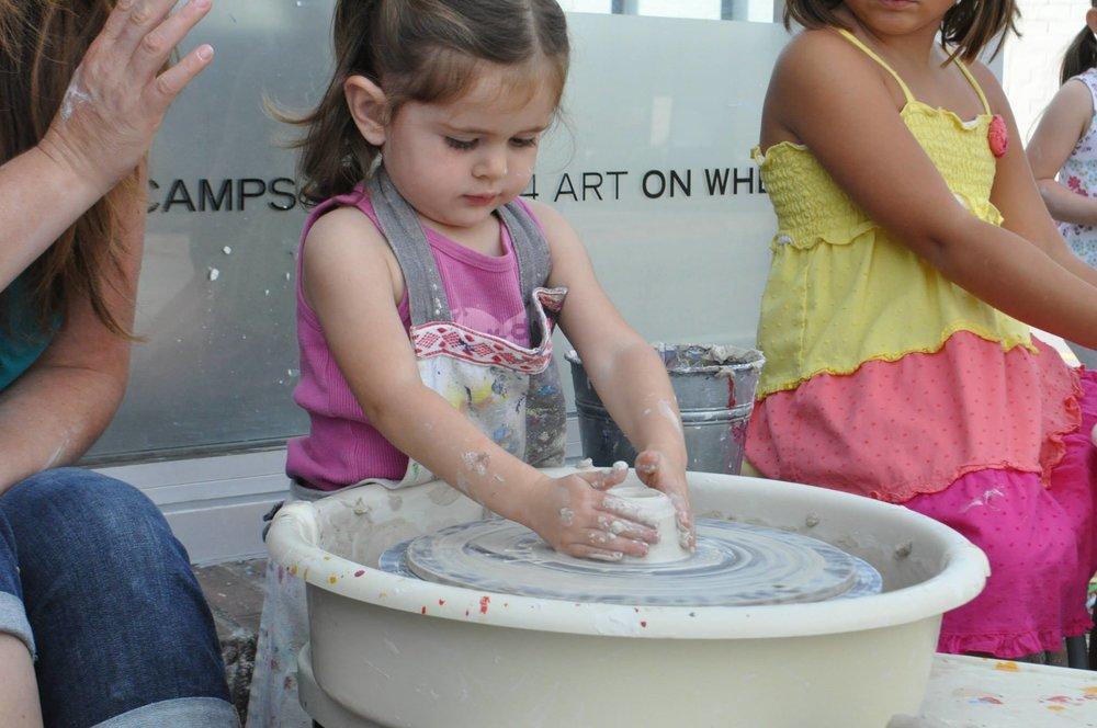 wheel throwing toddler.jpg