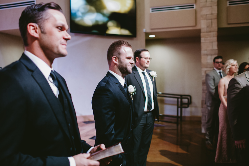 groom sees bride walking down aisle
