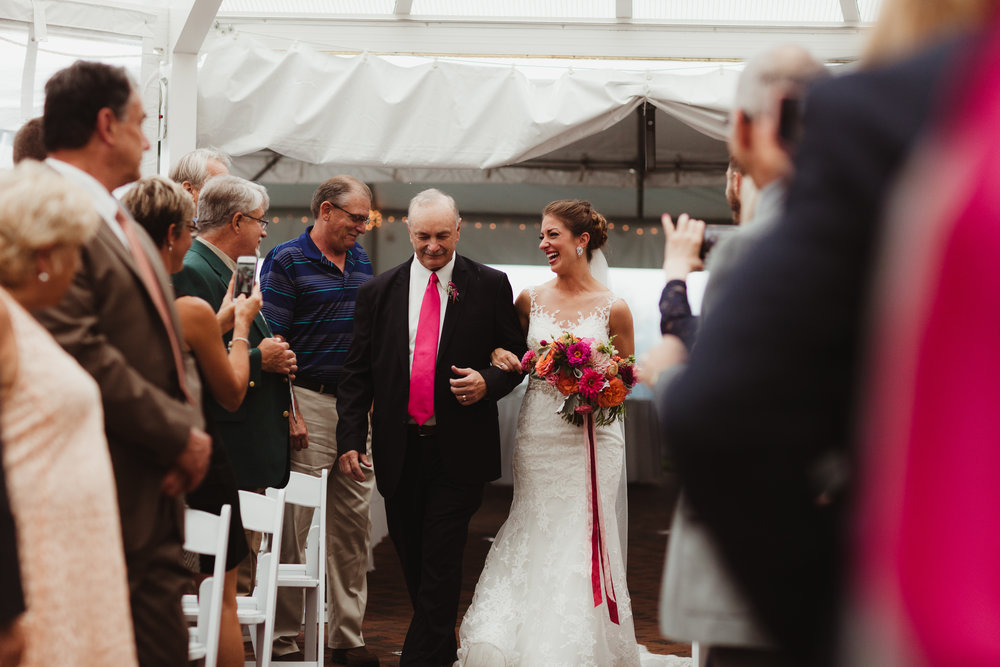 dad walking daughter down the aisle