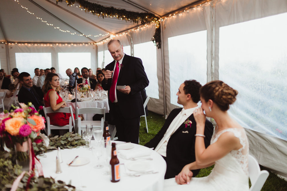 wedding reception under a tent with garland