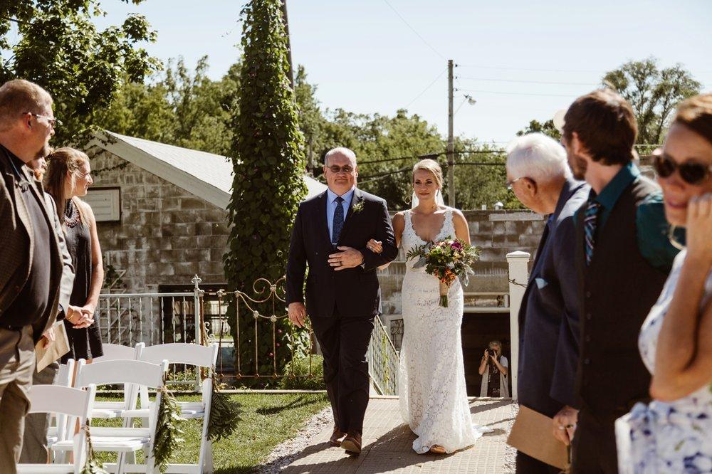 bride walking down the aisle at sundace studios ceremony