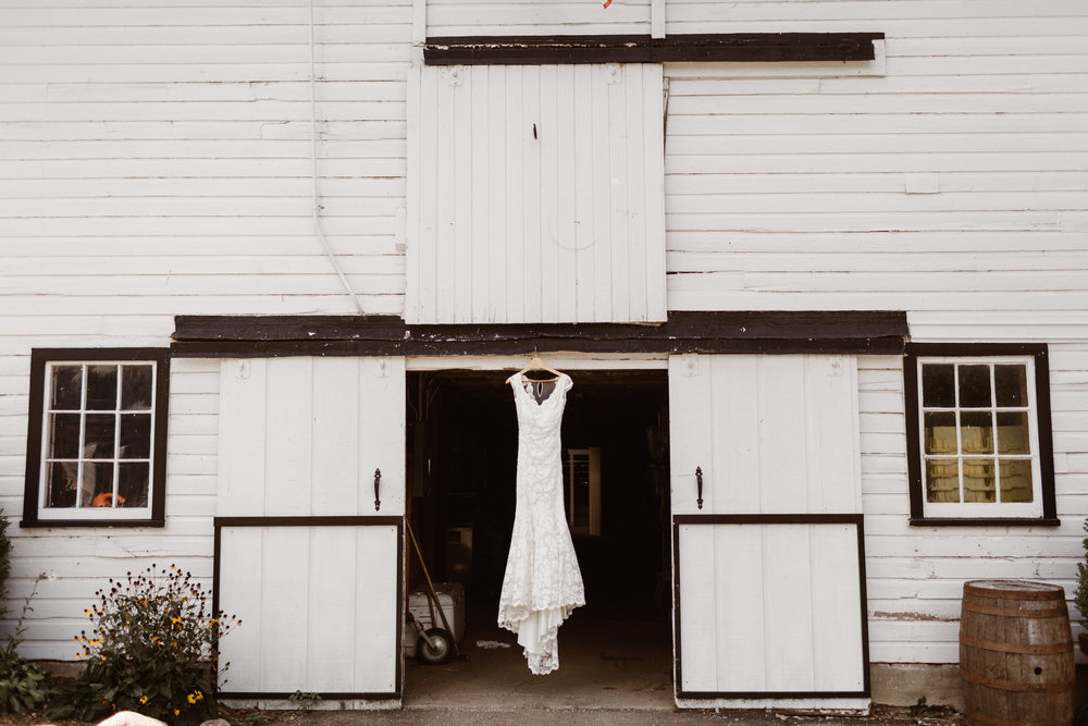 rustic barn with wedding dress
