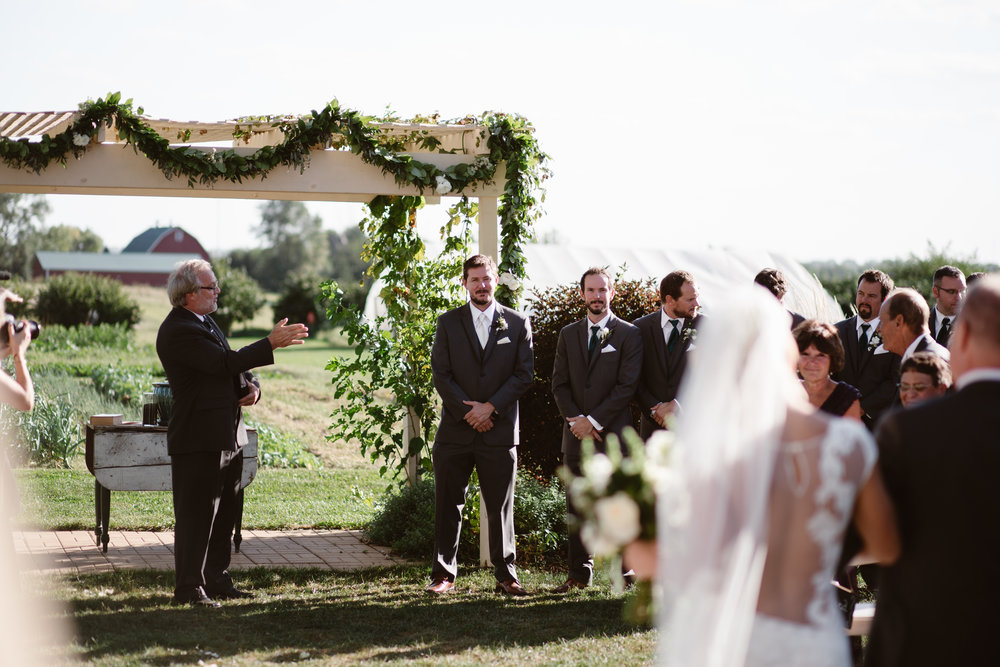grooms reaction to seeing bride at farm wedding