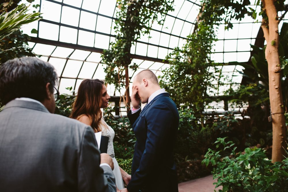 groom getting emotional during greenhouse elopement