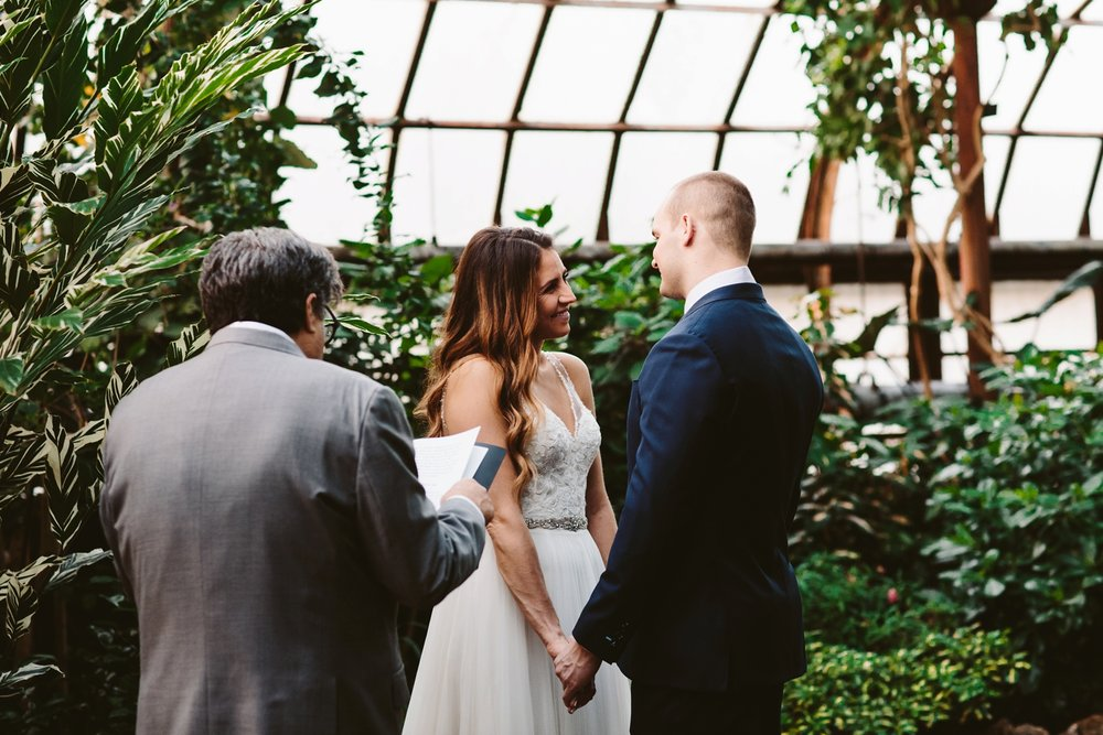 handwritten vows during botanical garden elopement in europe