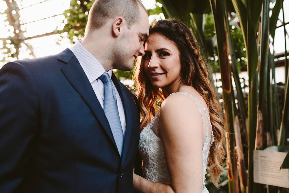 intimate and personal elopement in a palm filled greenhouse