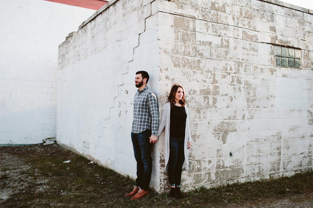 engagement session on textured walls of downtown minneapolis