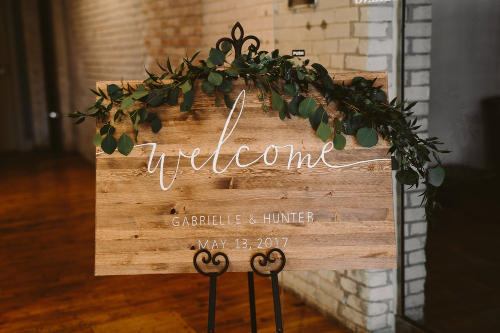 diy wood welcome sign at barker loft wedding reception