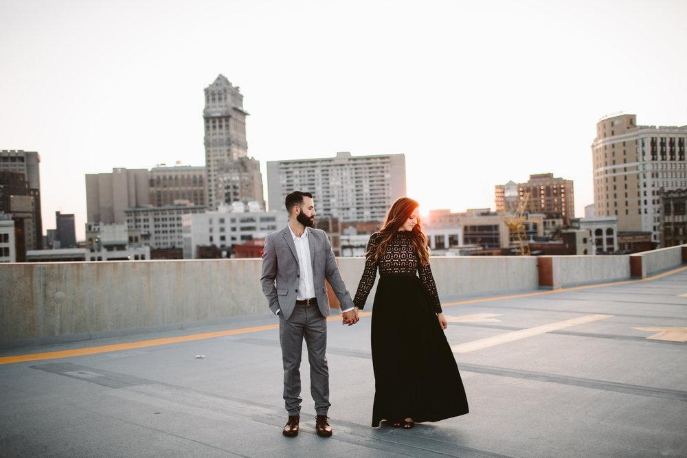 engagement session at sunset on detroit parking garage rooftop