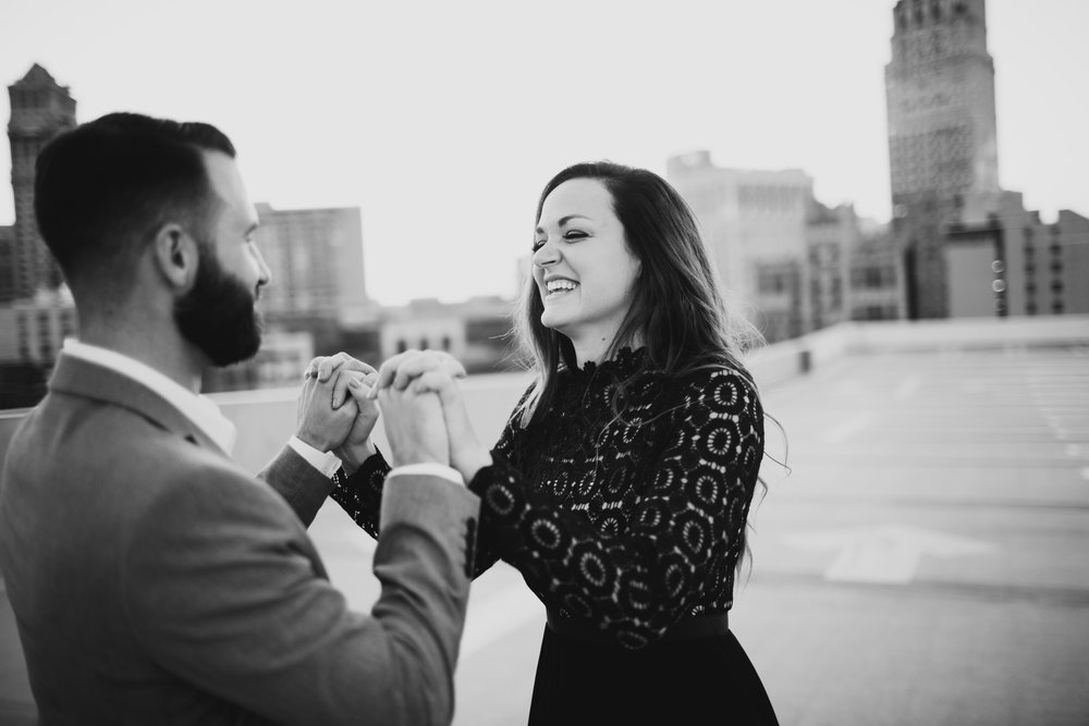 engagement session of rooftop with view of downtown detroit