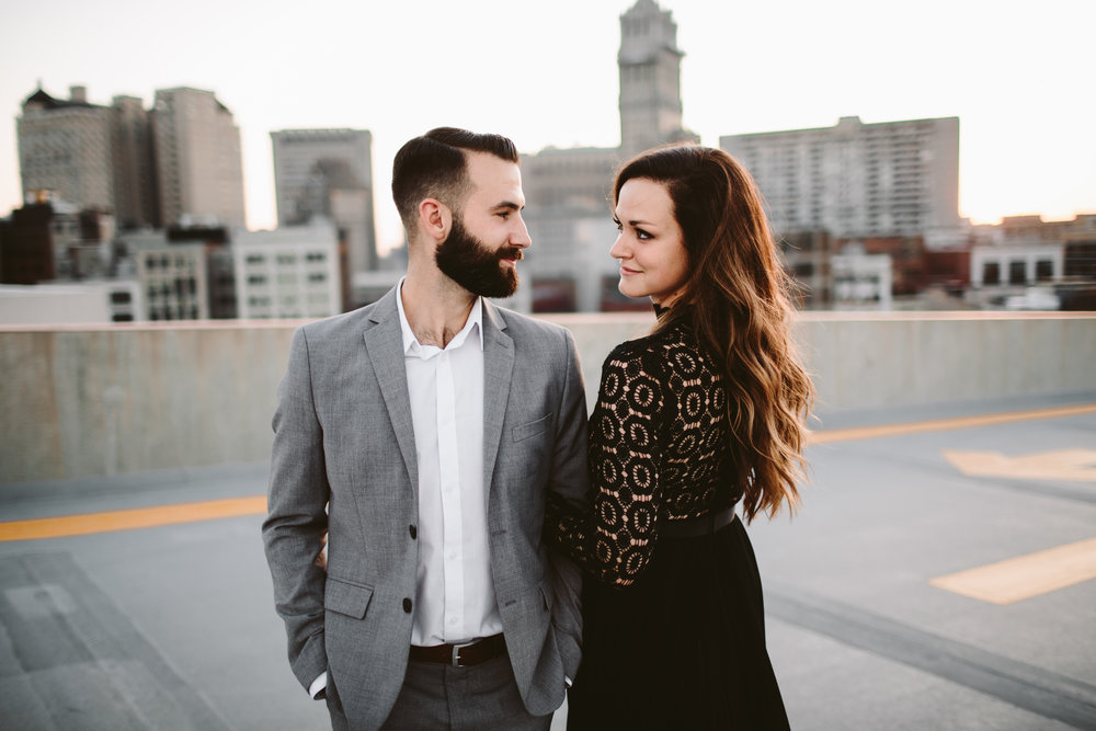 engagement session on parking garage rooftop at sunset in michigan