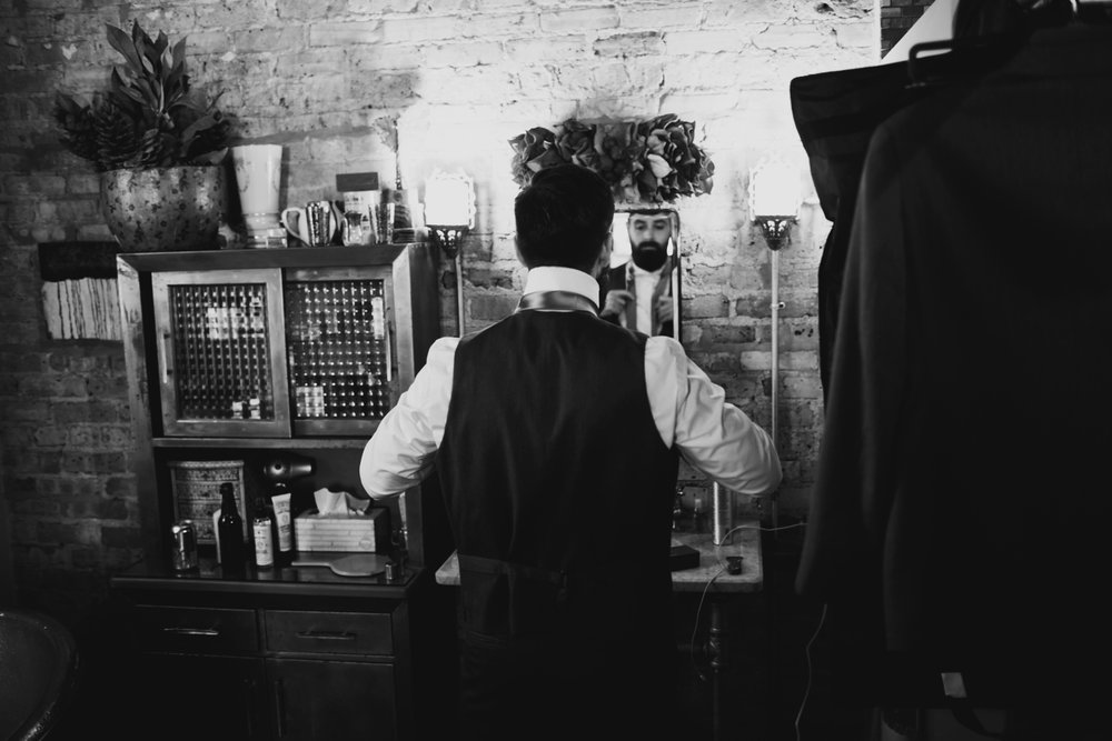 groom getting ready at firehouse chicago wedding venue