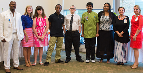 (left to right): Eric Tolbert, VR Job Coach; Katherine Harris, Business Liaison, Palmetto Health Parkridge; Project SEARCH graduates Taylor Keeshan, Rodheem Perry, Daniel Austin, Tarung Parikh, and Judith Gillings; Sandi Batten, Arc of the Midlands Job Coach; Elizabeth Magee, Instructor.