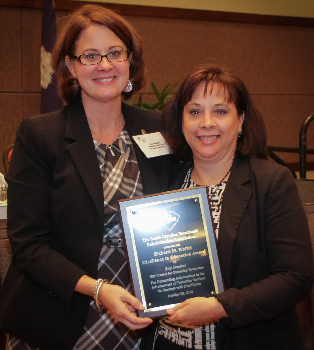 Joy Ivester   (left), Transition Alliance of South Carolina Program Director, receives the Richard M. Kuffel Excellence in Education Award from Laura Spears, VR Transition Services Coordinator.