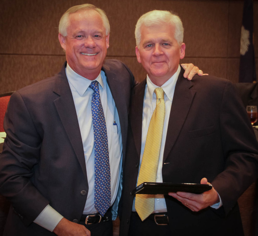John E. Batten, Esq. (left), accepts the Commissioner's Medal of Excellence Award from VR Commissioner Neal Getsigner.