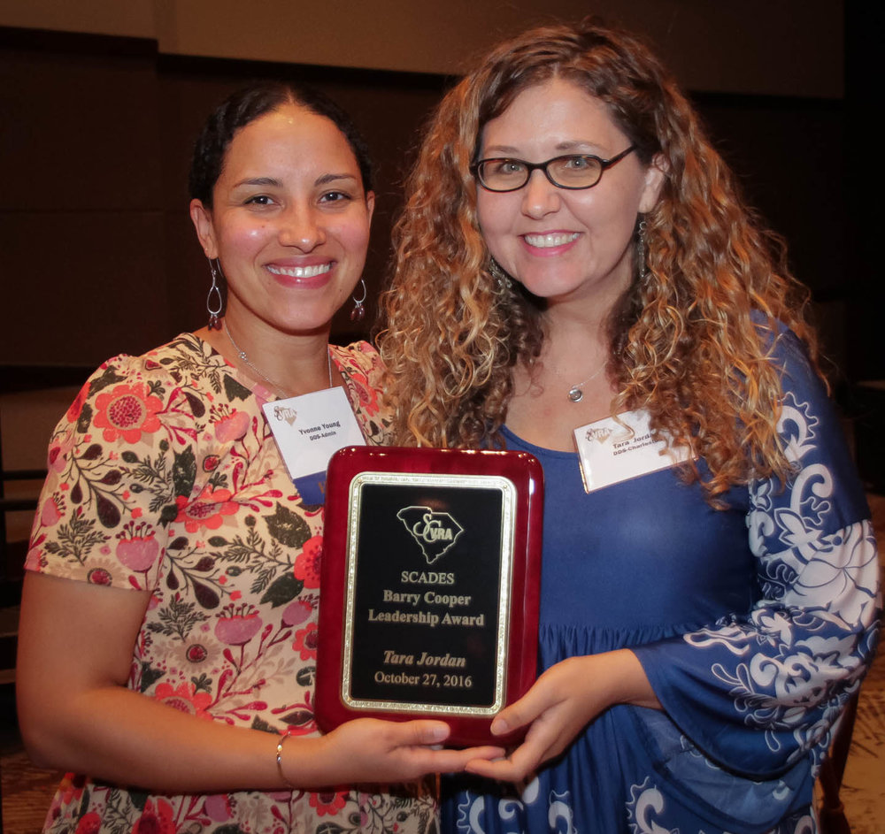 Tara Jordan (right), Disability Determination Hearing Officer, accepts the Barry Cooper Award for Leadership from Yvonne Young, SC Association of Disability Evaluation Specialists President.