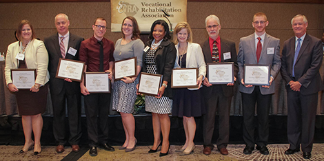(left to right) Niki Ostrander, Client Services Specialist; Stephen Marshall, Business Services Coordinator; Troy Hall, Administrative Team Support Specialist; Ella Durham, Counselor; Karen Hill Gordon, Business Development Specialist; Stacy Lever, Richland Area Supervisor; Tom Jackman, Rehabilitation Technology Manager; Joe Anthony, Engineering Associate; Neal Getsinger, VR Commissioner.