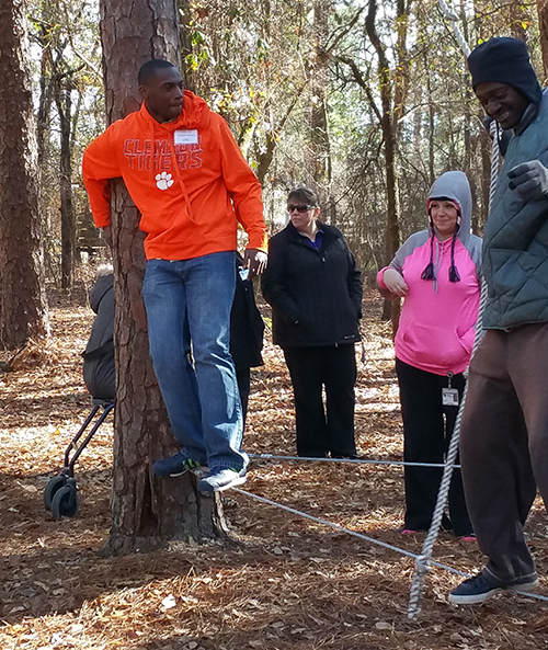 Deaf clients learn team-building skills on the ropes course at Wil Lou Gray.