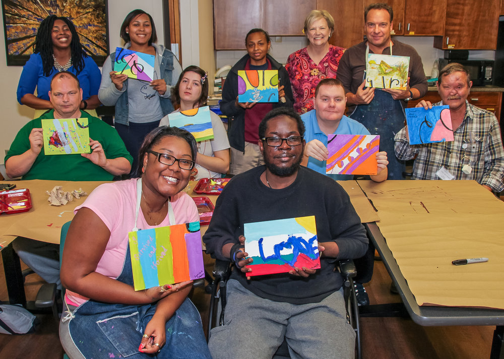 Back row (left to right): Shaquenta Byars, Occupational Therapy Assistant; Jada Risher, client; Gretchen Jackson, Intern; Janet Spires, Nurse Supervisor; Eric Kovak, client. Middle row: Clients John Fowler, Brittany Brooks, Tony Ramey, Ray Oswald. Front row: Clients Jamilah Robert, Levant Goodman.
