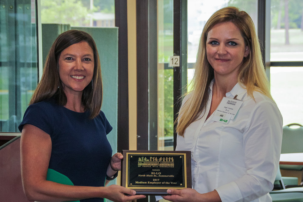 Angel Jackson (right), store manager at BI-LO on North Main Street in Summerville, accepts the Medium Employer of the Year Award from Kelly Sieling of the Summerville Mayor's Committee and the SC Vocational Rehabilitation Department's Berkeley-Dorchester area office.