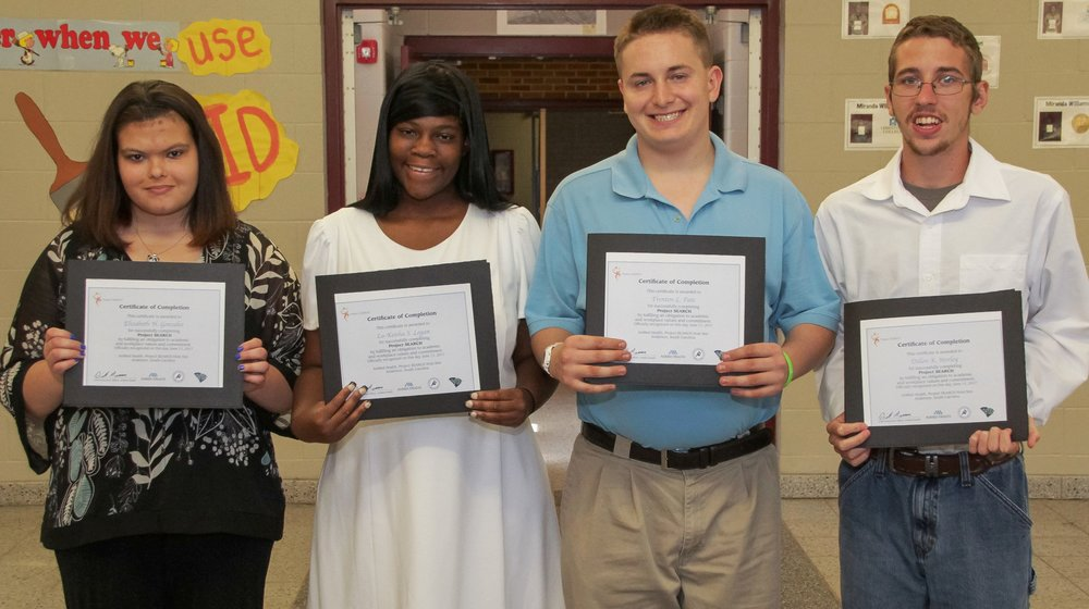 The first class of Project SEARCH graduates from AnMed Health (left to right): Elizabeth Gonzalez, La-Keisha Logan, Trenton Pate and Dillon Worley. Not pictured: Aron Gilliam.