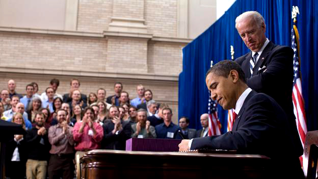 President Obama signs the American Recovery and Reinvestment Act as Vice President Biden watches in Denver, Colo. on Feb. 17, 2009. (White House photo by Pete Souza)