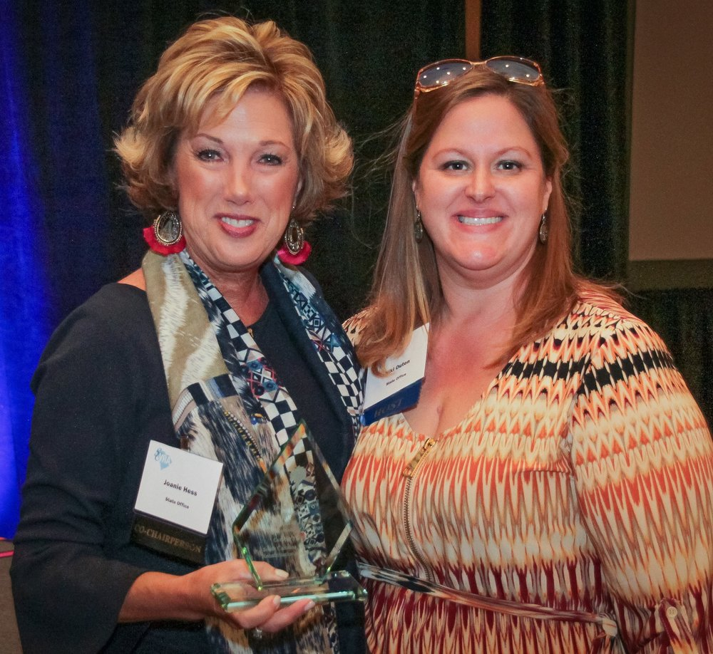 Joanie Hess (left), Administrator Coordinator, accepts the Technical Services Association Award from Niki Outen.
