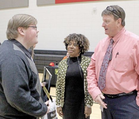 Liberty High School student Bradley Miller listens as Dan Alexander and Sandra Sloan of South Carolina Vocational Rehabilitation talk during the third annual Graduates to Work Job Fair in Liberty earlier this month. Rex Brown | The Journal.
