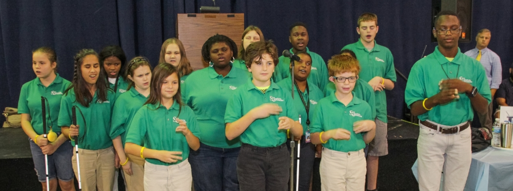 The South Carolina School for the Deaf and the Blind chorus performs, both signing and singing.