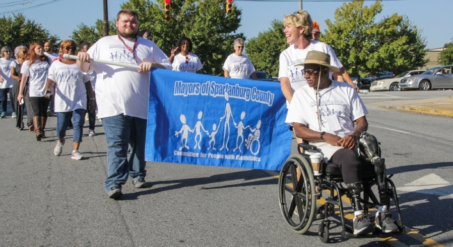 Donald Davis (right), Sr, Co-chair, Spartanburg Mayor's Committee, led more than 600 individuals in a parade from Morgan Square to Spartanburg Memorial Auditorium.
