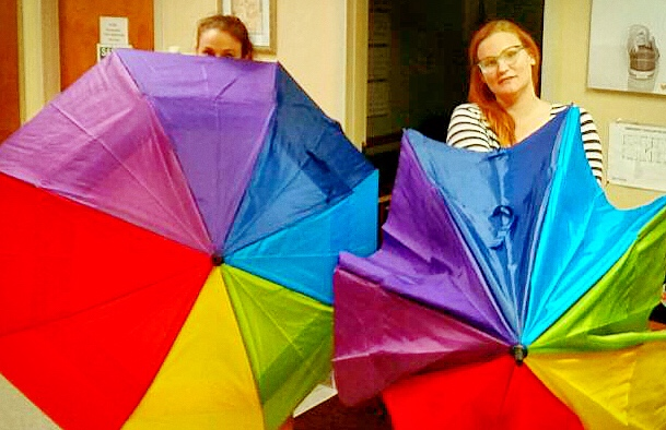 Clinic workers test out the newly donated rainbow umbrellas that will be used to protect our patients from the protesters' cameras and graphic signs.