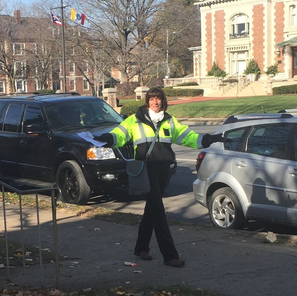 An anti-choice protester outside of FWHC dresses in the same reflective yellow worn by the clinic's volunteers, as described in Michelle's statement. This is also the same protester involved in the physical incident described by Buxi.