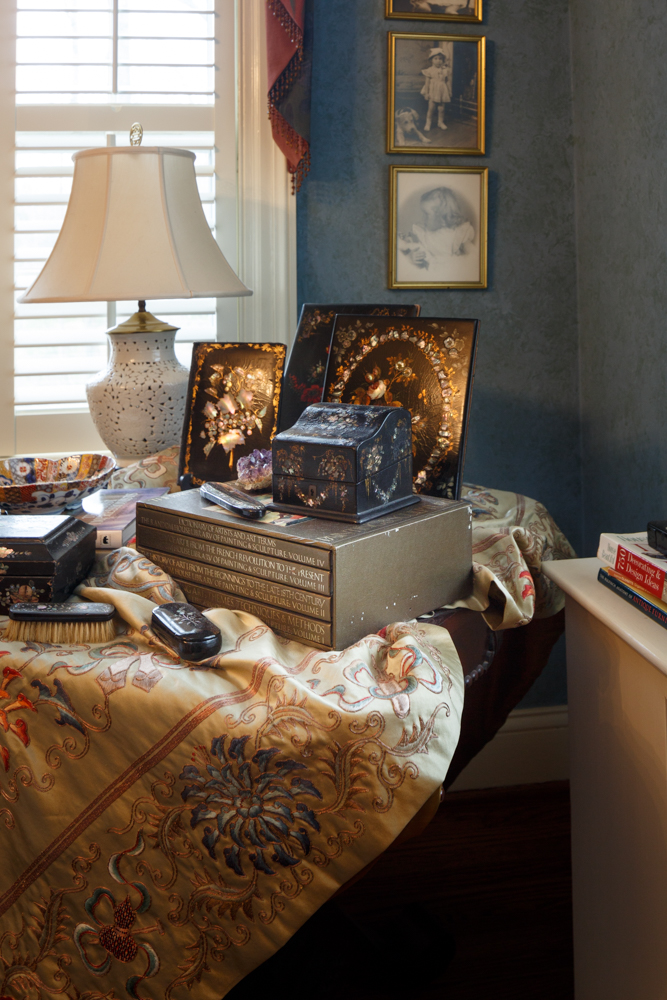 fabric-covered-table-with-books-inlaid-plates.jpg