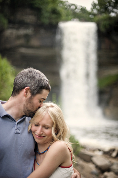 engaged couple in front of Minnehaha Falls