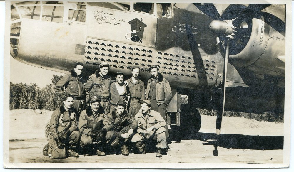 The flight and ground crew of Outhouse Mouse, a B-25 that flew more than 100 missions in the Mediterranean Theatre.