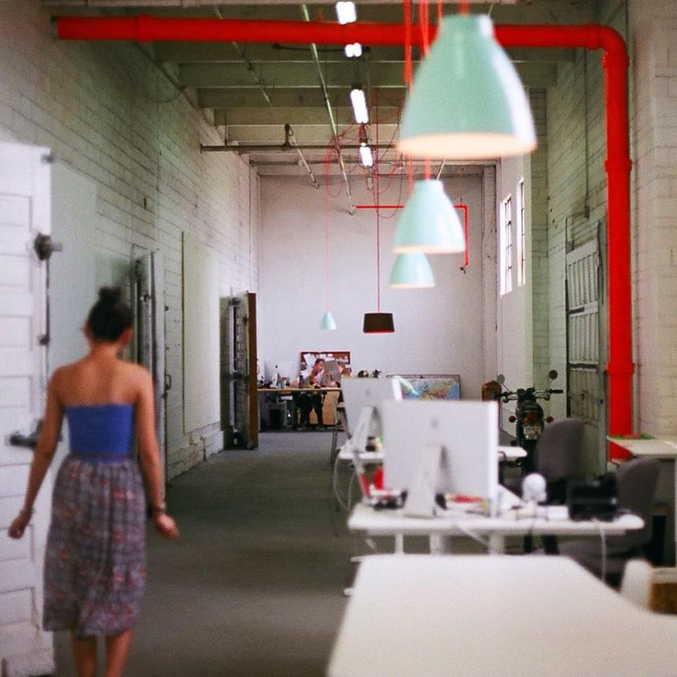 The Color Cord Warehouse. Helen (customer relations) walking towards Meggan & Beau (co-founders).