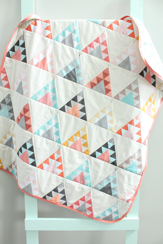 3. PETUNIAS: Baby Quilt £86 .  Such a perfect gift for a new baby! Made by mama of 4, Kelly, her teepee and aztec baby quilts and swaddle blankets are beautiful.