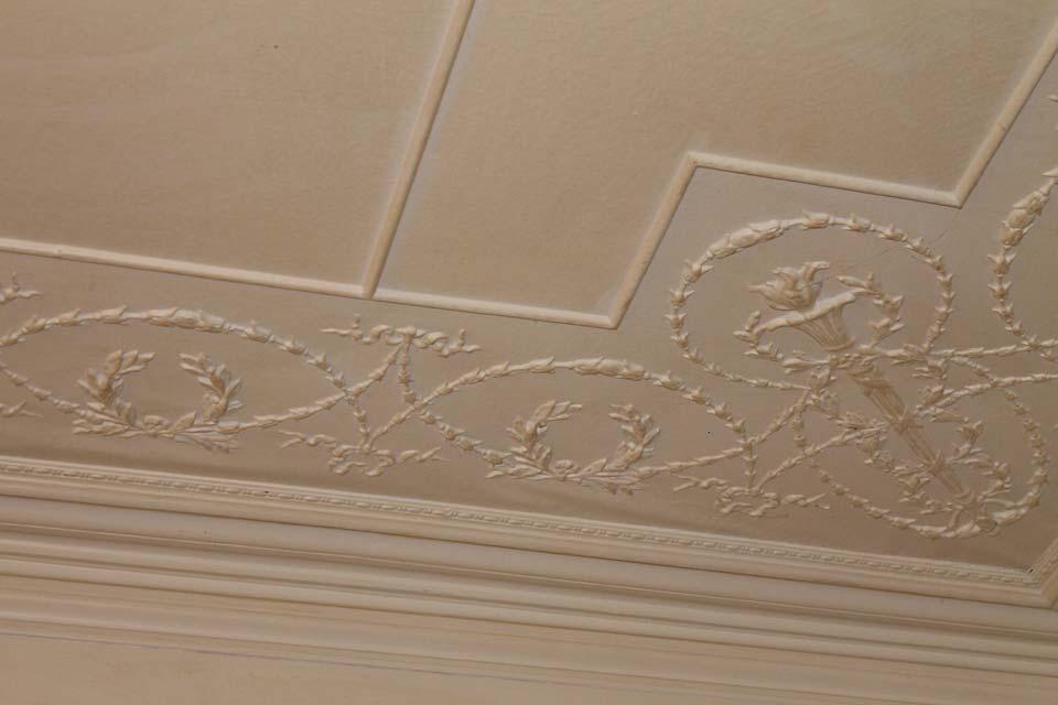 Historic craftsmanship of a pressed leather ceiling at Burlington's Willard Street Inn.