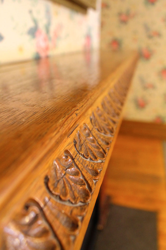 Original, Carved oak mantel at Vermont Inn.