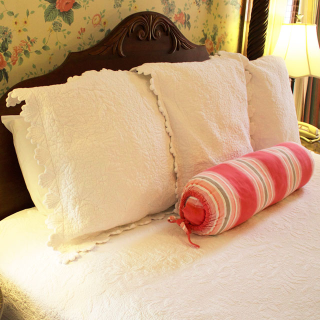 Soft, Plush pillows adorn the king, four-post bed in the conservatory at WSInn.