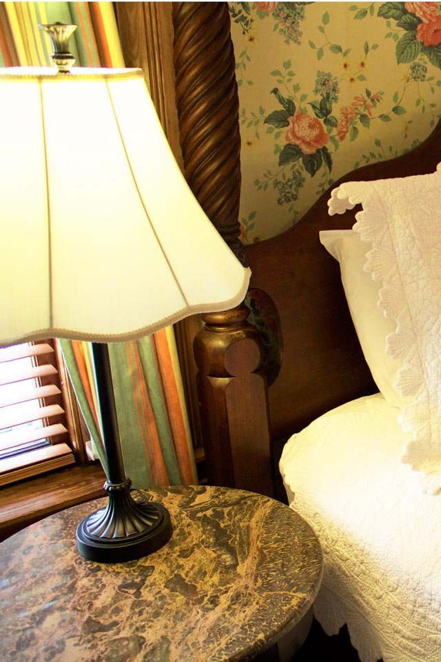 Marble topped bedside tables sit bedside in Room 1 at the Willard St Inn, VT.