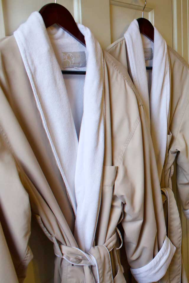 Plush bathrobes await you in the bathroom of Victorian Cabernet at this Burlington Inn.