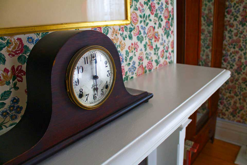Antique clock atop the ornamental mantel in the Victorian Cabernet.