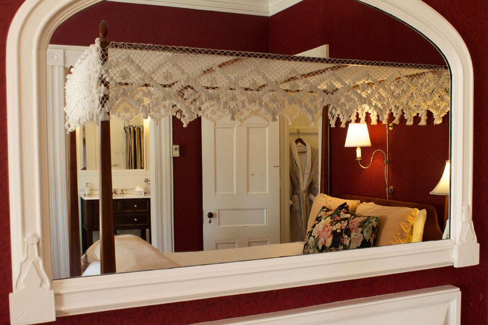 Antique wall mounted mirror over reflects luxury amenities of Champlain Lookout at Vermont's Willard Street Inn.
